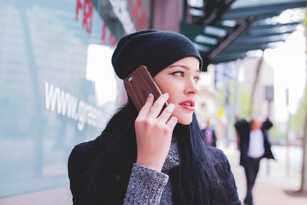 reverse phone look up by a worried person talking on the phone